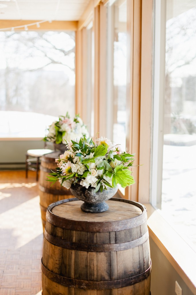 Rustic Wedding Ceremony Altar Flowers on Barrels