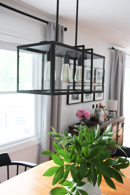 Industrial light fixture in dining room   Lumber Loves Lace   lumberloveslace.com